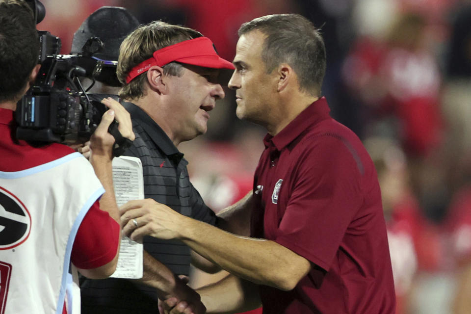 Georgia coach Kirby Smart shakes hands with South Carolina coach Shane Beamer, right, after an NCAA college football game Saturday, Sept. 18, 2021, in Athens, Ga. Georgia won 40-13. (AP Photo/Butch Dill)
