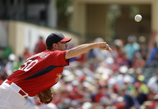 St. Louis Cardinals starting pitcher Adam Wainwright throws in the first inning of an exhibition spring training baseball game against the New York Mets, Sunday, March 16, 2014, in Jupiter, Fla. (AP Photo/David Goldman)