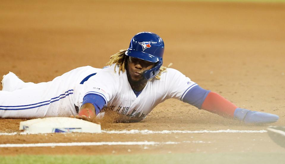 TORONTO, ON- MAY 22  - Toronto Blue Jays third baseman Vladimir Guerrero Jr. (27) slides back into first base  as the Toronto Blue Jays play the Boston Red Sox  at  Rogers Centre in Toronto. May 22, 2019.        (Steve Russell/Toronto Star via Getty Images)