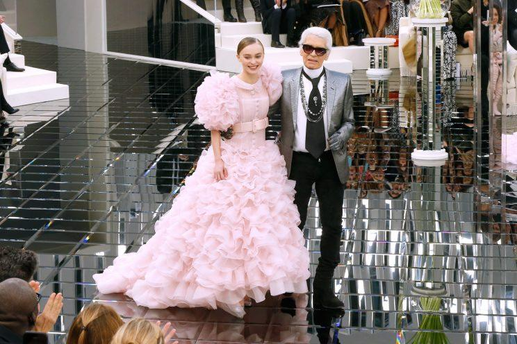 Lily-Rose Depp and Karl Lagerfeld at the Chanel show. (Photo: Getty Images)