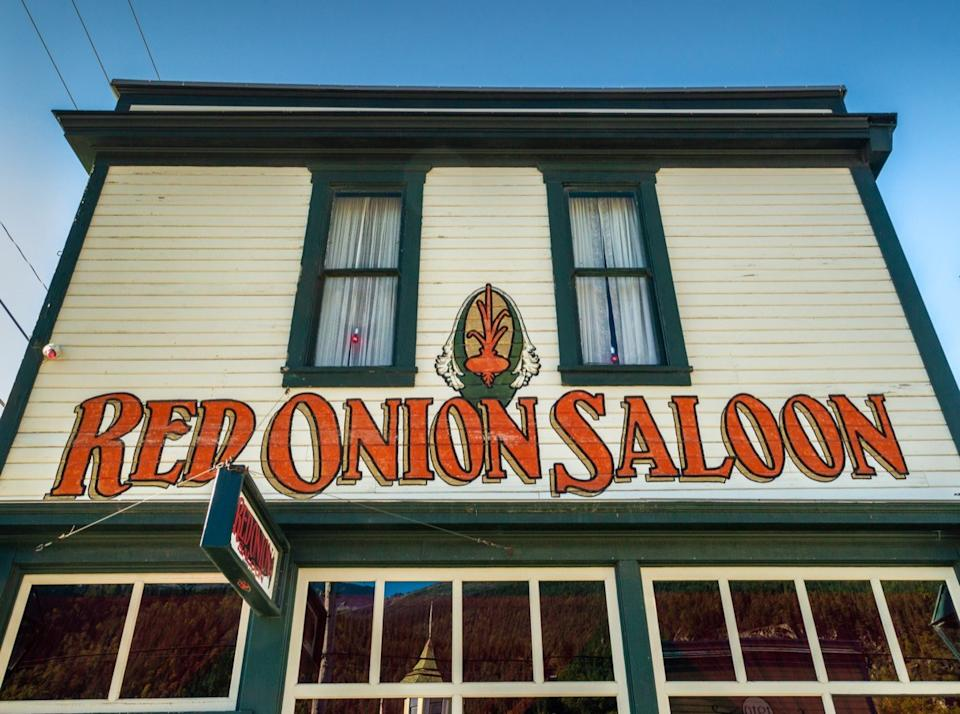 building front of the red onion saloon in alaska