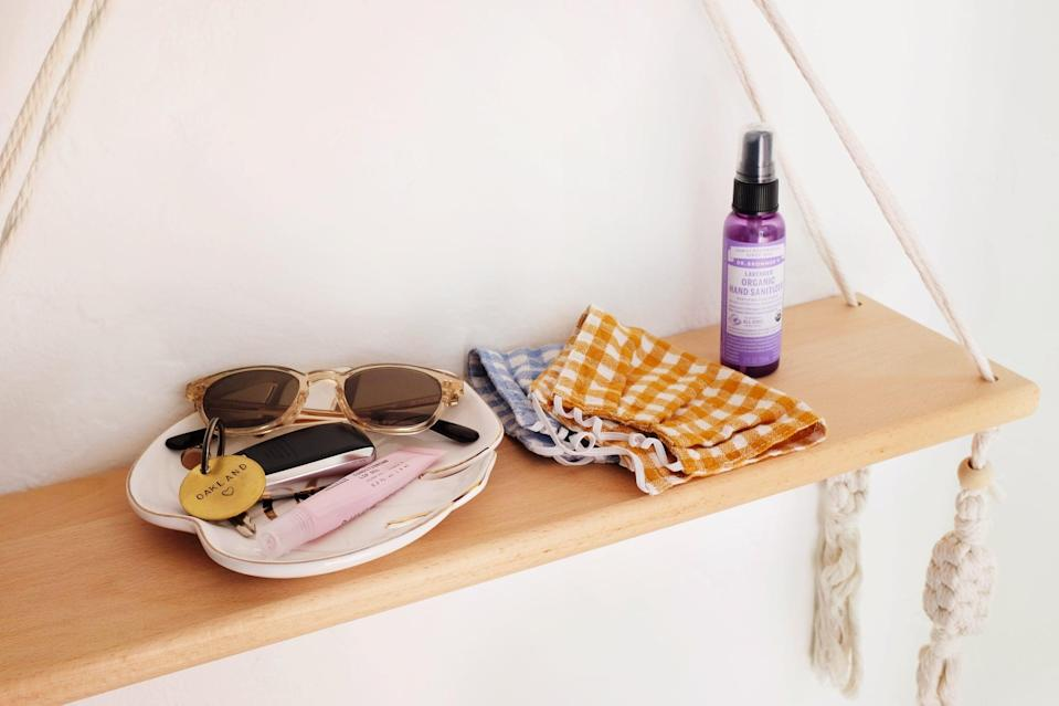 <p>Keep your entry shelf from looking cluttered with a pretty tray to hold your sunglasses, keys, and lip balm. Don't forget the hand sanitizer and masks. Perfect for grab-and-go access!</p>