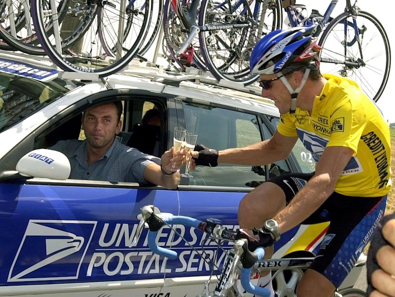 "FILE - In this July 28, 2002, file photo, overall leader Lance Armstrong of Austin, Texas, toast team director Johan Bruyneel with a glass of champagne during the final stage of the Tour de France cycling race between Melun and Paris, France. The U.S. Anti-Doping Agency is bringing doping charges against the seven-time Tour de France winner, questioning how he achieved those famous cycling victories. Armstrong, who retired from cycling last year, could face a lifetime ban from the sport if he is found to have used performance-enhancing drugs. He maintained his innocence, saying: ""I have never doped."" (AP Photo/Peter Dejong, File)"