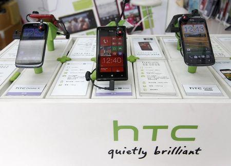 HTC smartphones are displayed in a mobile phone shop in Taipei