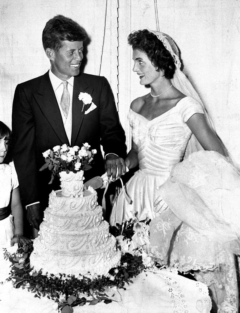 President John F. Kennedy with wife Jacqueline cut the cake at their wedding in Newport, Rhode Island. (Photo by Pat Candido/NY Daily News Archive via Getty Images)