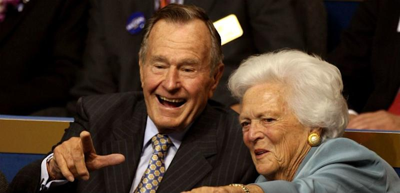 George H.W. and Barbara Bush Point at The Camera.