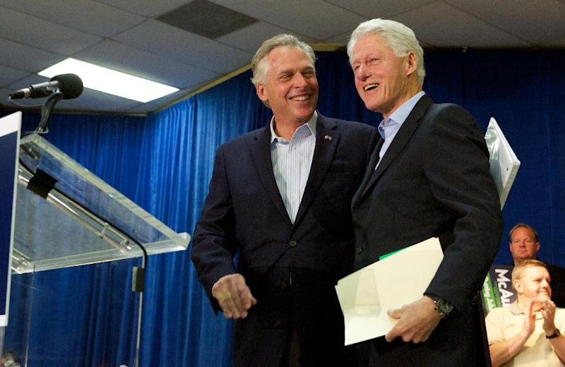 """Former President Bill Clinton prepares to speak at a campaign event, """"Putting Jobs First"""", for Democratic gubernatorial candidate for Virginia, Terry McAuliffe, left, in Dale City, Va., Sunday, Oct. 27, 2013. (AP Photo/Molly Riley)"""