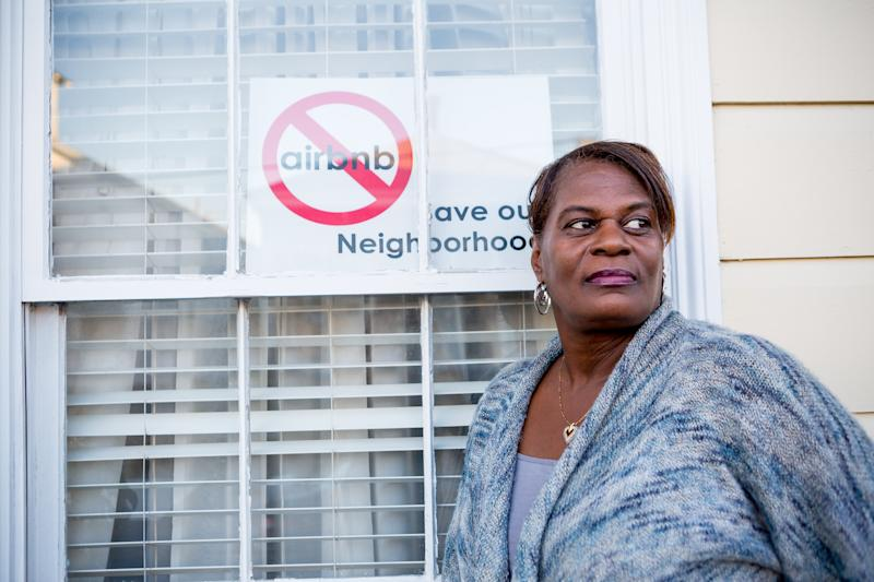JaniceCoatney stands outside her Treme home.