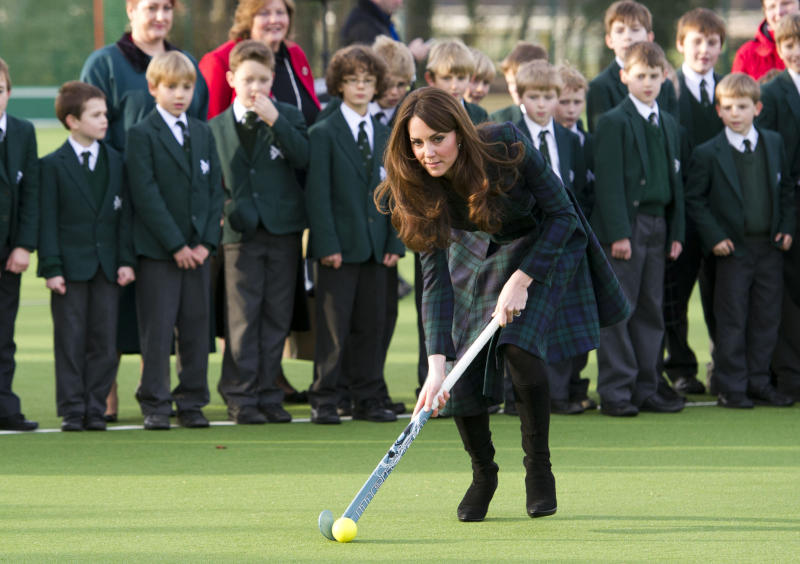 "Kate, the Duchess of Cambridge, centre, plays hockey during her visit to St. Andrew's School, where she attended school from 1986 till 1995, in Pangbourne, England, Friday, Nov. 30, 2012. The Duchess of Cambridge has gone back to school. The royal, formerly known as Kate Middleton, played hockey and revealed her childhood nickname — Squeak — when she returned to her elementary school for a visit Friday. Kate told teachers and students at the private St. Andrew's School in southern England that her 10 years there were ""some of my happiest years."" She said that she enjoyed it so much that she had told her mother she wanted to return as a teacher. (AP Photo/Arthur Edwards, Pool)"