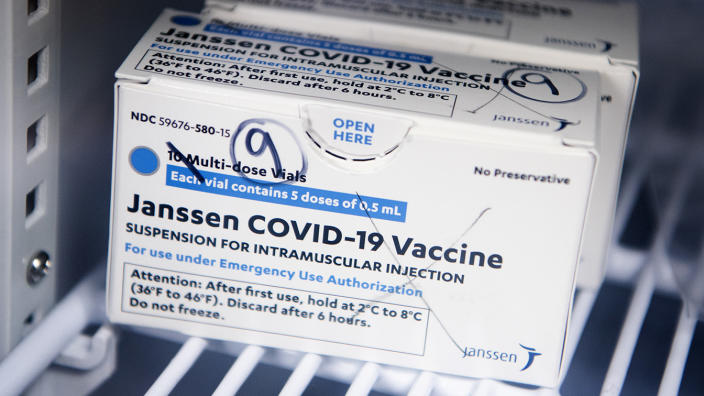 Box of Johnson & Johnson's Janssen COVID-19 vaccine doses on a refrigerator shelf