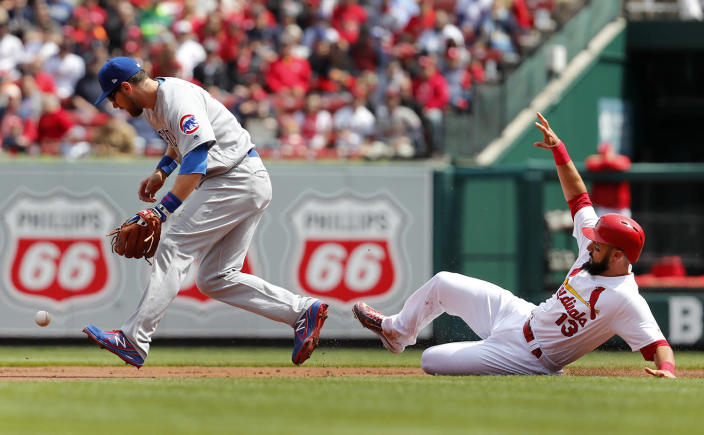 <p>St. Louis Cardinals' Matt Carpenter (13) is safe at second as Chicago Cubs second baseman Ben Zobrist drops the ball during the first inning of a baseball game on April 6, 2017, in St. Louis. (Photo: Jeff Roberson/AP) </p>