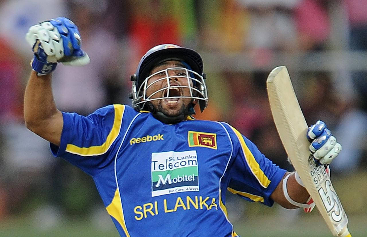 Sri Lankan cricketer Tillakaratne Dilshan leaps in the air celebrating after scoring a century (100 runs) during the second one-day international (ODI) match between Sri Lanka and Pakistan at the Pallekele International Cricket Stadium in Pallekele on June 9, 2012. AFP PHOTO/ LAKRUWAN WANNIARACHCHI