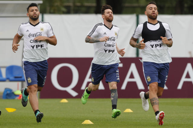 From left to right, Sergio Aguero, Lionel Messi and Nicolas Otamendi jog during a training session of Argentina at the 2018 soccer World Cup in Bronnitsy, Russia, Tuesday, June 19, 2018. (AP Photo/Ricardo Mazalan)