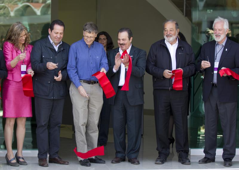 From left, Chair of the International Center for Improvement of Corn and Wheat (CIMMYT) Sara Boettiger, Mexico state Gov. Eruviel Avila, Microsoft Chairman Bill Gates, Mexican Secretary of Agriculture Enrique Martinez, Mexican telecommunications tycoon Carlos Slim and CIMMYT Director General Thomas Lumpkin cut the ribbon at inauguration of the new research center for the CIMMYT in Texcoco, Mexico, Wednesday, Feb. 13, 2013. Gates and Slim teamed up to to fund new seed breeding research which the CIMMYT says aims to sustainably increase the productivity of maize and wheat systems to ensure global food security and reduce poverty. (AP Photo/Eduardo Verdugo)