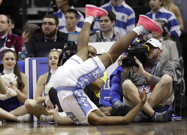 North Carolina's Coby White (2) flips over after chasing a loose ball against Duke during the first half of an NCAA college basketball game in the Atlantic Coast Conference tournament in Charlotte, N.C., Friday, March 15, 2019. (AP Photo/Chuck Burton)