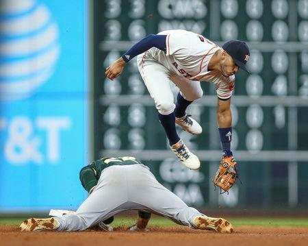FILE PHOTO: Aug 28, 2018; Houston, TX, USA; Oakland Athletics center fielder Ramon Laureano (22) is safe at second base with a stolen base as Houston Astros shortstop Carlos Correa (1) attempts to apply a tag during the fourth inning at Minute Maid Park. Mandatory Credit: Troy Taormina-USA TODAY Sports