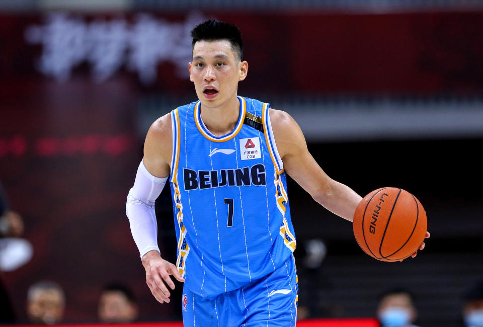 This photo taken on August 4, 2020 shows Beijing Ducks' Jeremy Lin driving the ball during the Chinese Basketball Association (CBA) match between Beijing Ducks and Guangdong Southern Tigers in Qingdao in China's eastern Shandong province. (Photo by STR / AFP) / China OUT (Photo by STR/AFP via Getty Images)