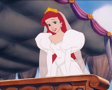 <p>When Ariel finally gets to marry Prince Eric and live on land, she wears a white wedding dress with puffy, long sleeves and a sweetheart neckline.</p>