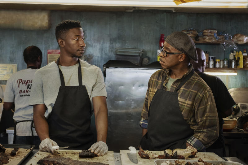 """This image released by Netflix shows Mamoudou Athie, left, and Courtney B. Vance in a scene from """"Uncorked."""" (Nina Robinson/Netflix via AP)"""