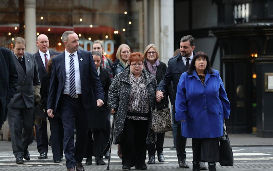 The families of those who were murdered are seeking damages from John Downey
