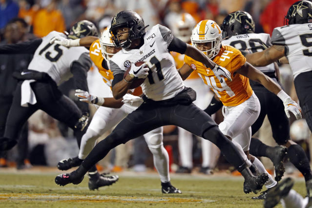 Vanderbilt wide receiver Justice Shelton-Mosley (11) runs for yardage as he's chased by Tennessee defensive back Cheyenne Labruzza (44) in the first half of an NCAA college football game Saturday, Nov. 30, 2019, in Knoxville, Tenn. (AP Photo/Wade Payne)