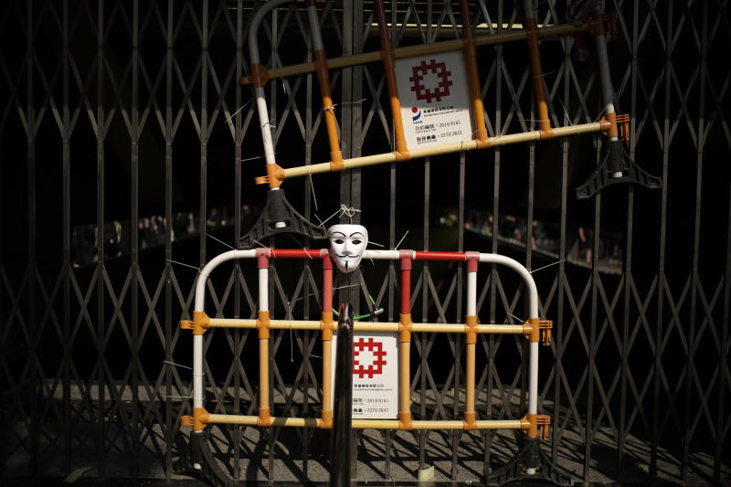 A mask hangs at the entrance of a closed public transport station in Hong Kong, Oct. 1, 2019. (Photo: Felipe Dana/AP)