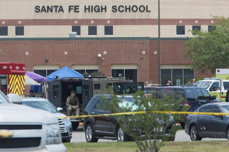 Emergency crews gather in the parking lot of Santa Fe High School, where at least eight people were killed by a heavily armed student