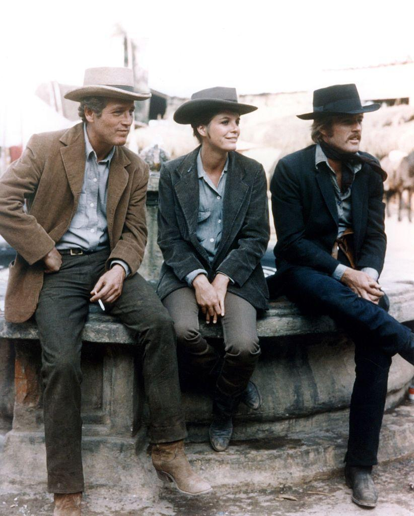 <p>Paul Newman, Katharine Ross, and Robert Redford take a seat on the set of <em>Butch Cassidy and the Sundance Kid</em>. </p>