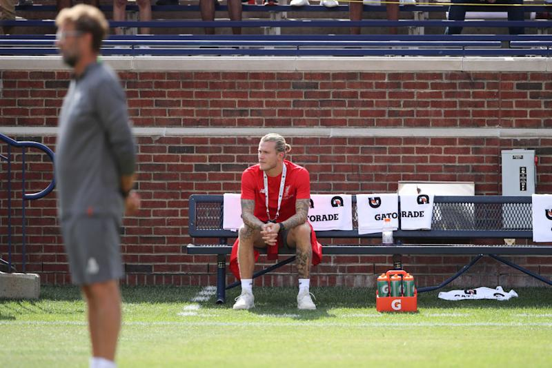 ANN ARBOR, MI - JULY 28: Jurgen Klopp the head coach / manager of Liverpool stands with goalkeeper Loris Karius sitting alone on a bench and not in the team prior to the International Champions Cup 2018 match between Manchester Untied and Liverpool at Michigan Stadium on July 28, 2018 in Ann Arbor, Michigan. (Photo by Matthew Ashton - AMA/Getty Images)