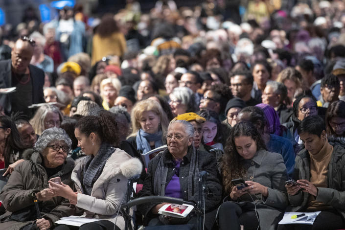 Mourners congregate before the start of the Celebration of the Life of Toni Morrison, Thursday, Nov. 21, 2019, at the Cathedral of St. John the Divine in New York. (AP Photo/Mary Altaffer)