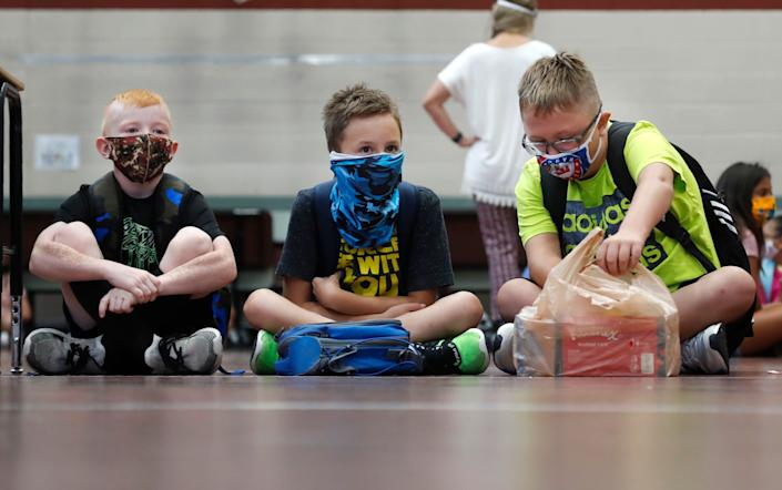 Elementary school students wait for classes to begin in Godley, Texas, on Wednesday. States in the South and Southwest have recently seen the highest number of new coronavirus cases per capita. (Photo: ASSOCIATED PRESS)