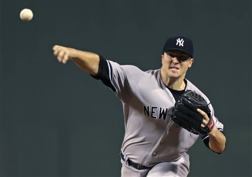 New York Yankees starting pitcher Phil Hughes delivers against the Boston Red Sox during the first inning of a baseball game, Thursday, Sept. 13, 2012, at Fenway Park in Boston. (AP Photo/Charles Krupa)