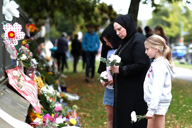 Members of the Muslim community lay flowers at the memorial wall at the Botanic Gardens on March 17, 2019 in Christchurch, New Zealand. 50 people are confirmed dead, with dozens injured still in hospital following shooting attacks on two mosques in Christchurch on Friday, March 15th.