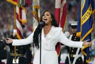 Demi Lovato performs the national anthem before the NFL Super Bowl 54 football game between the San Francisco 49ers and the Kansas City Chiefs Sunday, Feb. 2, 2020, in Miami Gardens, Fla. (AP Photo/David J. Phillip)