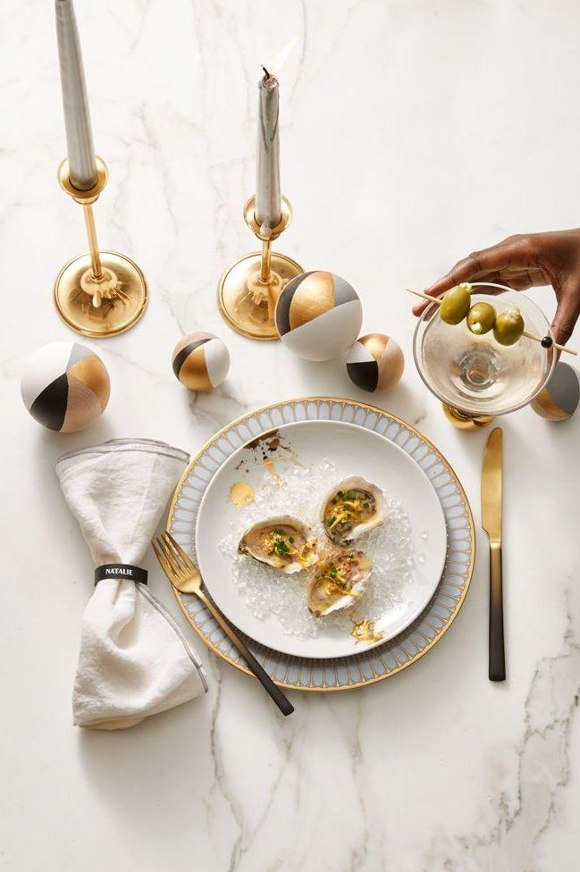 <p>Even if your parties are smaller in scale, you can still make them feel as glamorous as ever with perfectly coordinated place settings, complete with coordinating plates, flatware, and decorative accents in varying heights.</p>