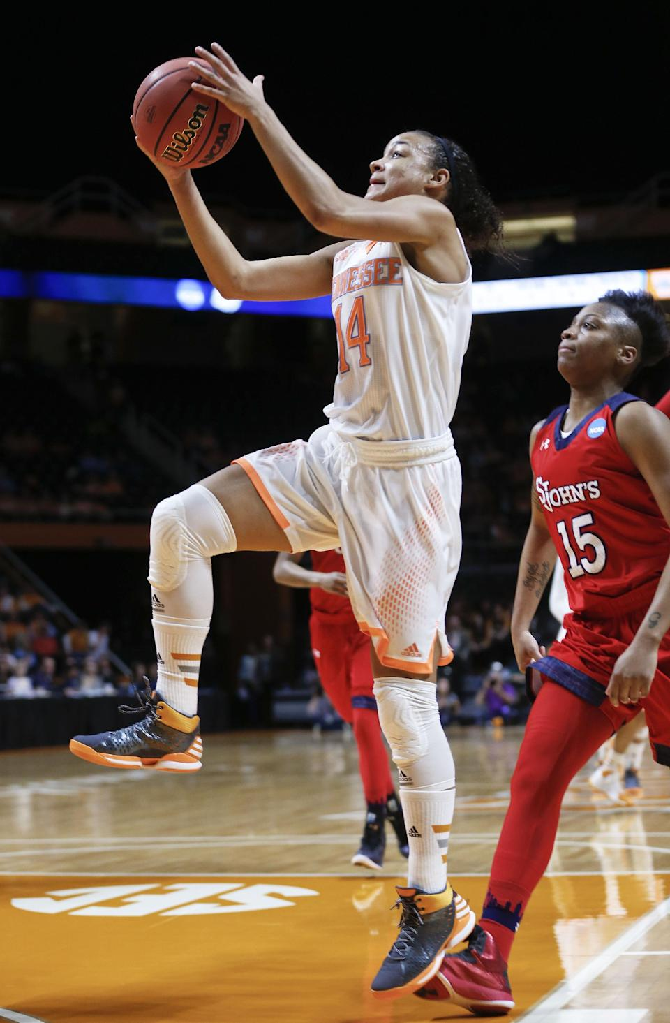 Tennessee guard Andraya Carter (14) drives ahead of St. John's guard Danaejah Grant (15) in the first half of an NCAA women's college basketball second-round tournament game Monday, March 24, 2014, in Knoxville, Tenn. (AP Photo/John Bazemore)