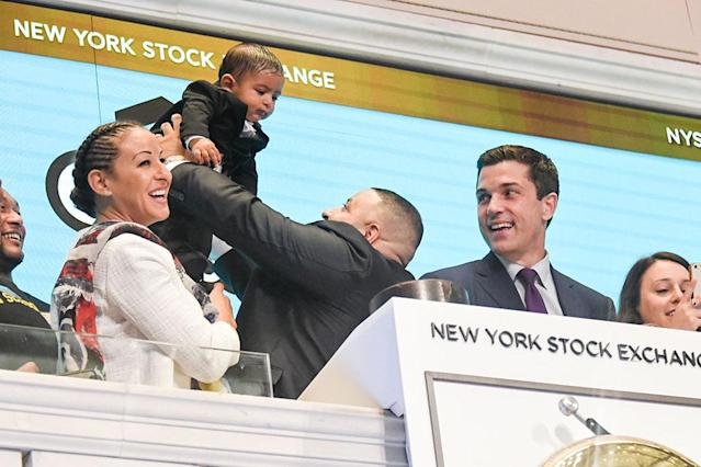 """<p>At the New York Stock Exchange, Khaled held up his <a href=""""https://www.yahoo.com/celebrity/dj-khaleds-baby-winning-instagram-174725084.html"""" data-ylk=""""slk:social media-savvy"""" class=""""link rapid-noclick-resp"""">social media-savvy</a> baby boy, 7-and-a-half-month-old Asahd, at the opening bell ceremony to promote Get Schooled's """"Keys to Success"""" campaign. Of course, fiancée Nicole Tuck was there, too. (Photo: Mike Coppola/Getty Images) </p>"""