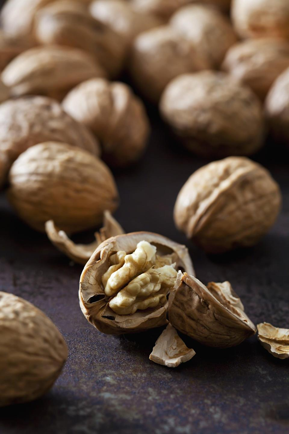 "<p>Walnuts contain <a href=""http://walnuts.org/nutrition/nutrition-info/protein-fiber-magnesium-and-phosphorous/"" class=""link rapid-noclick-resp"" rel=""nofollow noopener"" target=""_blank"" data-ylk=""slk:44 milligrams of magnesium per ounce"">44 milligrams of magnesium per ounce</a>, making them a great plant-based source of this important mineral. They're also rich in omega-3 fatty acids and fiber, and data suggests that making walnuts a regular part of your diet can <a href=""http://www.mdpi.com/2072-6643/10/2/244"" class=""link rapid-noclick-resp"" rel=""nofollow noopener"" target=""_blank"" data-ylk=""slk:improve gut health"">improve gut health</a>.</p> <p>If you suffer from depressive symptoms, eating walnuts may help in that department, too. In one study evaluating more than 25,000 people, <a href=""http://www.mdpi.com/2072-6643/11/2/275"" class=""link rapid-noclick-resp"" rel=""nofollow noopener"" target=""_blank"" data-ylk=""slk:depression scores were significantly lower among those who ate nuts"">depression scores were significantly lower among those who ate nuts</a> - and particularly among those who ate walnuts - compared to those who didn't.</p>"