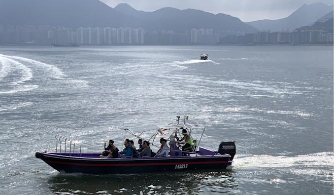 Those who didn't want to wait for a ferry paid enterprising speedboat owners for a ride. Photo: Kinling Lo