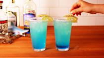 """<p>These icy blue margaritas were made for drinking by the ocean, but they'll probably taste just as good in your backyard. </p><p><strong><em>Get the recipe at <a href=""""https://www.delish.com/cooking/recipe-ideas/recipes/a53910/blue-crush-margaritas-recipe/"""" rel=""""nofollow noopener"""" target=""""_blank"""" data-ylk=""""slk:Delish"""" class=""""link rapid-noclick-resp"""">Delish</a>. </em></strong></p>"""