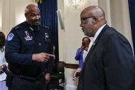 U.S. Capitol Police Sgt. Harry Dunn speaks with Chairman Rep. Bennie Thompson, D-Miss., after a House select committee hearing on the Jan. 6 attack on Capitol Hill in Washington, Tuesday, July 27, 2021. (Andrew Caballero-Reynolds/Pool via AP)