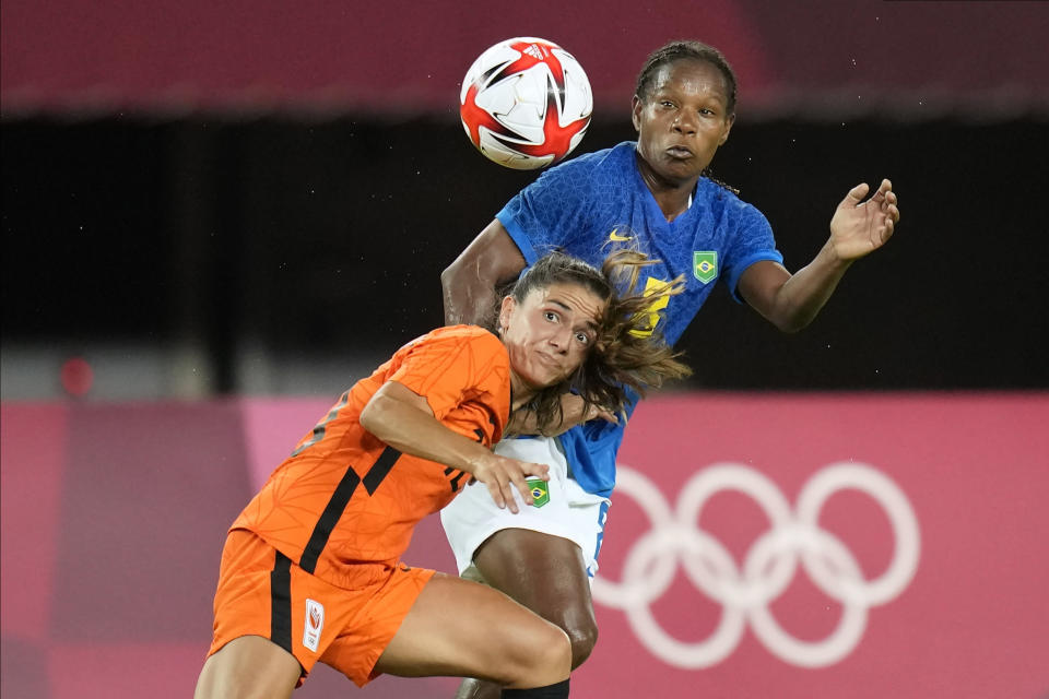 Netherlands' Danielle van de Donk, left, and Brazil's Formiga battle for the ball during a women's soccer match at the 2020 Summer Olympics, Saturday, July 24, 2021, in Miyagi, Japan. (AP Photo/Andre Penner)