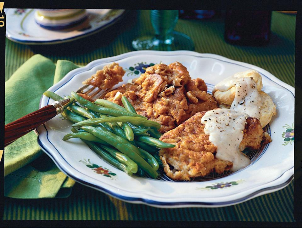 """<p><strong>Recipe: <a href=""""https://www.southernliving.com/syndication/fried-pork-chops-with-cream-gravy"""" rel=""""nofollow noopener"""" target=""""_blank"""" data-ylk=""""slk:Fried Pork Chops with Cream Gravy"""" class=""""link rapid-noclick-resp"""">Fried Pork Chops with Cream Gravy</a></strong></p> <p>You might be surprised to learn that golden brown fried pork chops come together in just 30 minutes. </p>"""