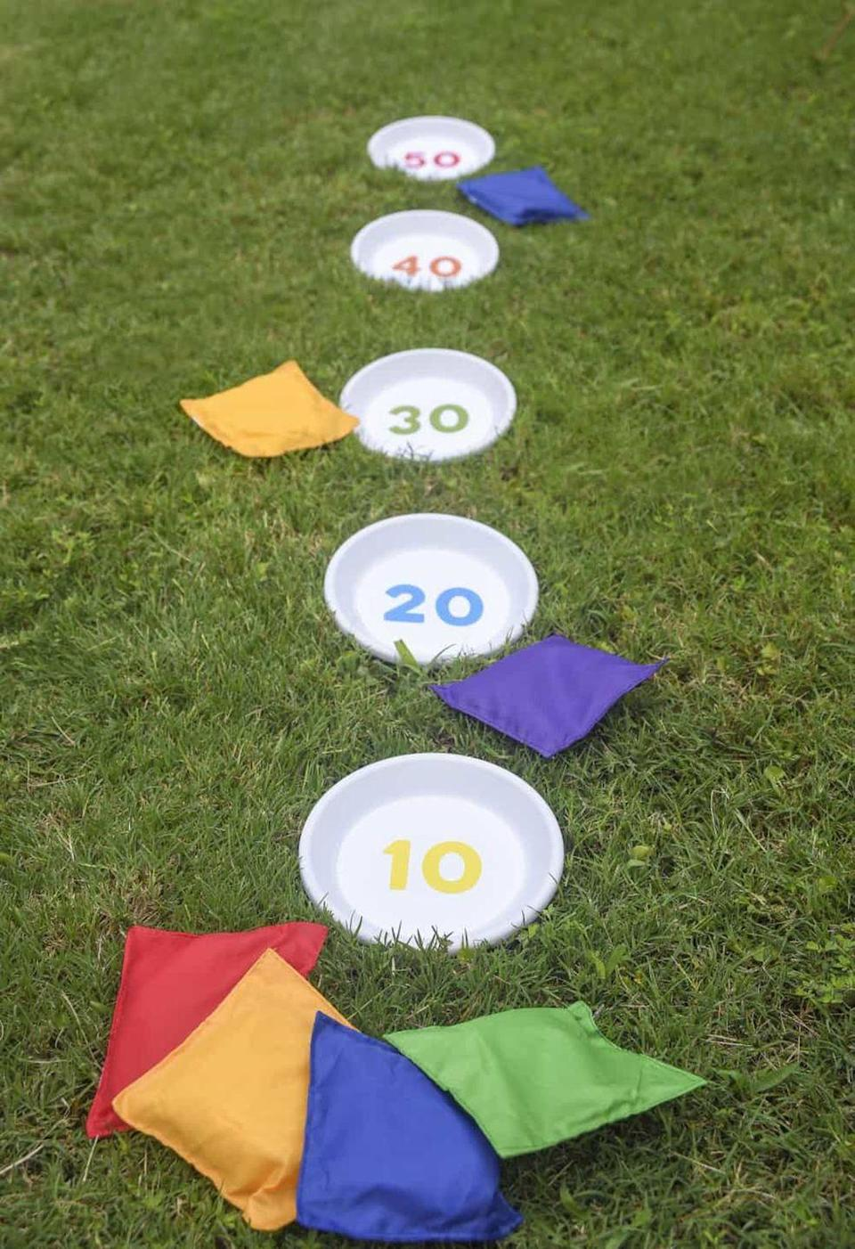 """<p>Blogger Amy offers a free downloadable template so your targets can look colorful and uniform.</p><p><strong>Get the tutorial at <a href=""""https://modpodgerocksblog.com/outdoor-games-diy-bean-bag-toss/"""" rel=""""nofollow noopener"""" target=""""_blank"""" data-ylk=""""slk:Modge Podge Rocks!"""" class=""""link rapid-noclick-resp"""">Modge Podge Rocks!</a></strong></p><p><strong><a class=""""link rapid-noclick-resp"""" href=""""https://www.amazon.com/Round-Plastic-Plant-Saucer-Units/dp/B01GVUU034?tag=syn-yahoo-20&ascsubtag=%5Bartid%7C10050.g.21095894%5Bsrc%7Cyahoo-us"""" rel=""""nofollow noopener"""" target=""""_blank"""" data-ylk=""""slk:SHOP CLAY POT SAUCERS"""">SHOP CLAY POT SAUCERS</a></strong></p>"""