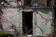 <p>A door of a house, collapsed by a 7.1-magnitude earthquake, stands in San Gregorio Atlapulco, Mexico, Friday, Sept. 22, 2017. Mexican officials are promising to keep up the search for survivors as rescue operations stretch into a fourth day following Tuesday's major earthquake that devastated Mexico City and nearby states. (AP Photo/Moises Castillo) </p>