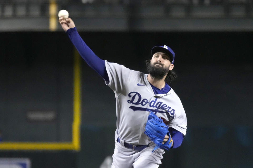 Los Angeles Dodgers pitcher Tony Gonsolin throws against the Arizona Diamondbacks in the first inning during a baseball game, Friday, July 30, 2021, in Phoenix. (AP Photo/Rick Scuteri)