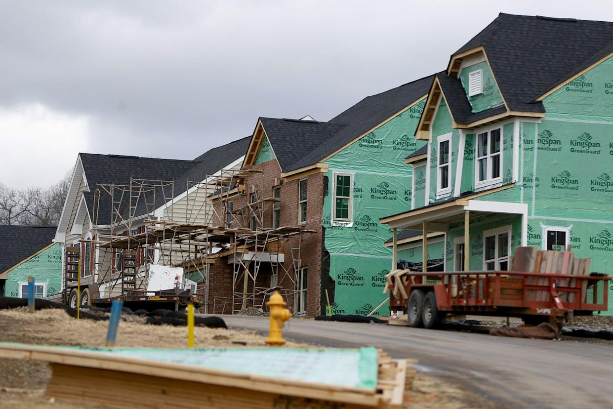 New home-building dropped the most in 8 months in February. (AP Photo/Keith Srakocic)