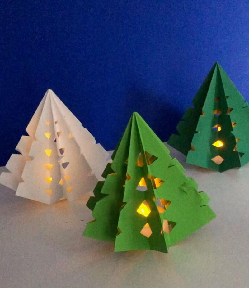 """It's just a paper snowflake taken a step further. Learn how to make it at <a href=""""https://www.redtedart.com/3d-paper-christmas-tree-luminary/"""" target=""""_blank"""" rel=""""noopener noreferrer"""">Red Ted Art</a>."""
