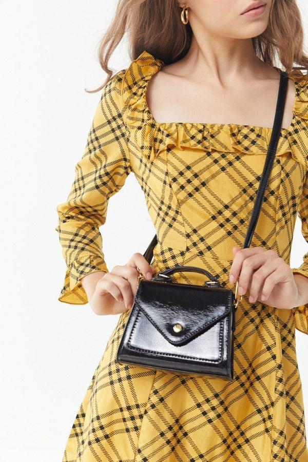 "<p>This little <a href=""https://www.popsugar.com/buy/Urban-Outfitters-Mini-Trapezoid-Bag-484501?p_name=Urban%20Outfitters%20Mini%20Trapezoid%20Bag&retailer=urbanoutfitters.com&pid=484501&price=30&evar1=fab%3Aus&evar9=46550460&evar98=https%3A%2F%2Fwww.popsugar.com%2Ffashion%2Fphoto-gallery%2F46550460%2Fimage%2F46550481%2FUrban-Outfitters-Mini-Trapezoid-Bag&list1=shopping%2Cbags%2Csale%2Csale%20shopping%2Chandbags&prop13=api&pdata=1"" rel=""nofollow"" data-shoppable-link=""1"" target=""_blank"" class=""ga-track"" data-ga-category=""Related"" data-ga-label=""https://www.urbanoutfitters.com/shop/mini-trapezoid-bag?category=accessories-for-sale&amp;color=001&amp;type=REGULAR"" data-ga-action=""In-Line Links"">Urban Outfitters Mini Trapezoid Bag</a> ($30, originally $44) fits just the essentials, and we love it.</p>"