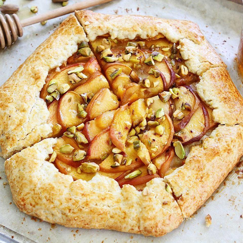 """<p>Everyone should have a good galette recipe on hand—and this one is perfect for summer. You'll love the combination of peaches and pistachios. </p><p><a href=""""https://www.thepioneerwoman.com/food-cooking/recipes/a56988/peach-pistachio-galette/"""" rel=""""nofollow noopener"""" target=""""_blank"""" data-ylk=""""slk:Get the recipe."""" class=""""link rapid-noclick-resp""""><strong>Get the recipe.</strong></a></p><p><a class=""""link rapid-noclick-resp"""" href=""""https://go.redirectingat.com?id=74968X1596630&url=https%3A%2F%2Fwww.walmart.com%2Fsearch%2F%3Fquery%3Dpioneer%2Bwoman%2Bcookware&sref=https%3A%2F%2Fwww.thepioneerwoman.com%2Ffood-cooking%2Frecipes%2Fg36382592%2Fpeach-desserts%2F"""" rel=""""nofollow noopener"""" target=""""_blank"""" data-ylk=""""slk:SHOP COOKWARE"""">SHOP COOKWARE</a></p>"""